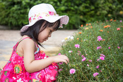 Asian Chinese little girl playing in outdoor garden Stock Photos