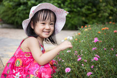 Asian Chinese little girl playing in outdoor garden Stock Images