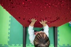 Asian Chinese little girl playing pin board Stock Photos