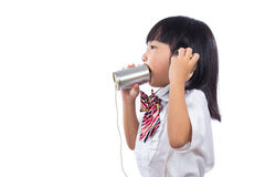 Asian Chinese little girl playing retro tin can phone Royalty Free Stock Photos
