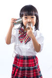 Asian Chinese little girl playing retro tin can phone Stock Image
