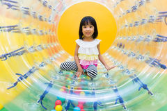 Asian Chinese Little Girl Playing Roller Wheel Royalty Free Stock Photos