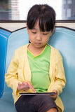 Asian Chinese little girl playing smart phone Royalty Free Stock Photo