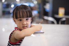 Asian Chinese little girl playing smartphone Royalty Free Stock Photo