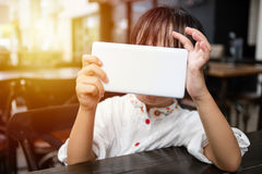 Asian Chinese little girl playing smartphone Royalty Free Stock Photos