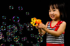 Asian Chinese Little Girl Playing Soap Bubbles Stock Image