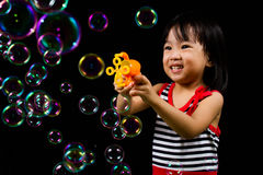 Asian Chinese Little Girl Playing Soap Bubbles Royalty Free Stock Photography