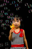Asian Chinese Little Girl Playing Soap Bubbles Royalty Free Stock Image