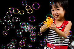 Asian Chinese Little Girl Playing Soap Bubbles Stock Photos