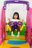 Asian Chinese little girl playing on swing Royalty Free Stock Photography