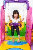 Asian Chinese little girl playing on swing Royalty Free Stock Photos