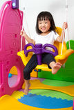 Asian Chinese little girl playing on swing Royalty Free Stock Image