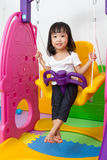 Asian Chinese little girl playing on swing Stock Images