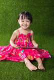 Asian Chinese little girl playing tablet computer Stock Photos
