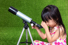 Asian Chinese little girl playing with a telescope Stock Photography
