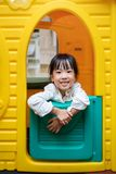 Asian Chinese little girl playing in toy house. At indoor playground Stock Photo