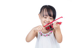Asian chinese little girl playing violin Royalty Free Stock Photo