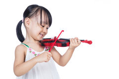 Asian chinese little girl playing violin Royalty Free Stock Image