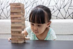 Asian Chinese little girl playing wooden stacks. At home Royalty Free Stock Photos
