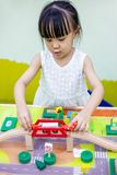 Asian Chinese little girl playing wooden toy train stock photos