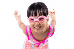 Asian Chinese little girl portrait wearing goggles and swimsuit Stock Photo