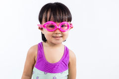 Asian Chinese little girl portrait wearing goggles and swimsuit Royalty Free Stock Images