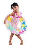 Asian Chinese little girl portrait wearing swimsuit with swim ri Royalty Free Stock Photo