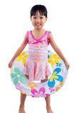 Asian Chinese little girl portrait wearing swimsuit with swim ri Stock Images