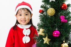 Asian Chinese little girl posing with Christmas Tree Royalty Free Stock Photo