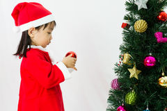 Asian Chinese little girl posing with Christmas Tree Stock Photography