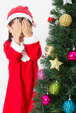 Asian Chinese little girl posing with Christmas Tree Stock Photos