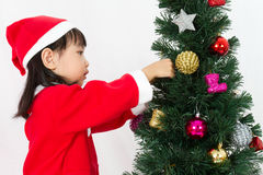 Asian Chinese little girl posing with Christmas Tree Royalty Free Stock Image
