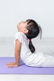 Asian Chinese little girl practicing yoga pose Stock Images