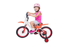 Asian Chinese little girl riding bicycle Royalty Free Stock Photography