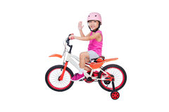 Asian Chinese little girl riding bicycle Stock Images