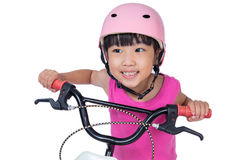 Asian Chinese little girl riding bicycle Stock Image