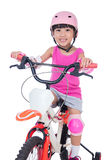 Asian Chinese little girl riding bicycle Stock Photos