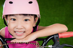 Asian Chinese little girl riding bicycle Royalty Free Stock Photo
