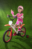 Asian Chinese little girl riding bicycle Royalty Free Stock Image