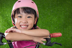 Asian Chinese little girl riding bicycle Stock Photo