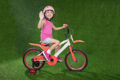 Asian Chinese little girl riding bicycle Royalty Free Stock Images