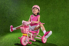 Asian Chinese little girl riding bicycle Stock Photography
