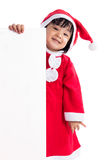 Asian Chinese little girl in santa costume holding blank message Stock Photos