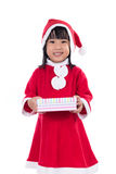Asian Chinese little girl in santa costume holding gift box Royalty Free Stock Image