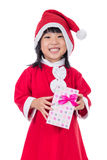 Asian Chinese little girl in santa costume holding gift box Royalty Free Stock Photography