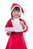 Asian Chinese little girl in santa costume holding gift box Royalty Free Stock Photos