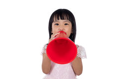 Asian Chinese little girl shouting with retro loudspeaker. In isolated white background Royalty Free Stock Photos
