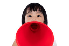 Asian Chinese little girl shouting with retro loudspeaker Stock Photography