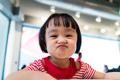 Asian Chinese little girl showing funny expression Stock Photos