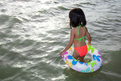 Asian Chinese little girl stepping into sea water Stock Images
